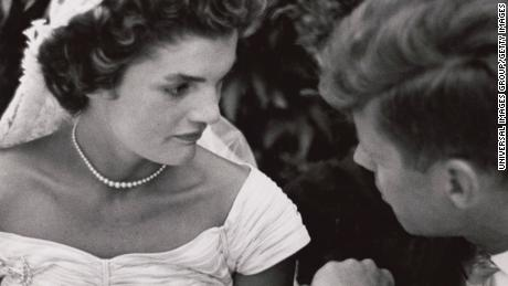 Jacqueline Bouvier Kennedy and Senator John F. Kennedy speak at their wedding in 1953.