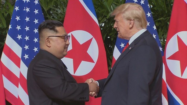 Photo of Kim Jong Un and Donald Trump meeting at the 2018 Singapore Summit. Photos: Courtesy of National Geographic