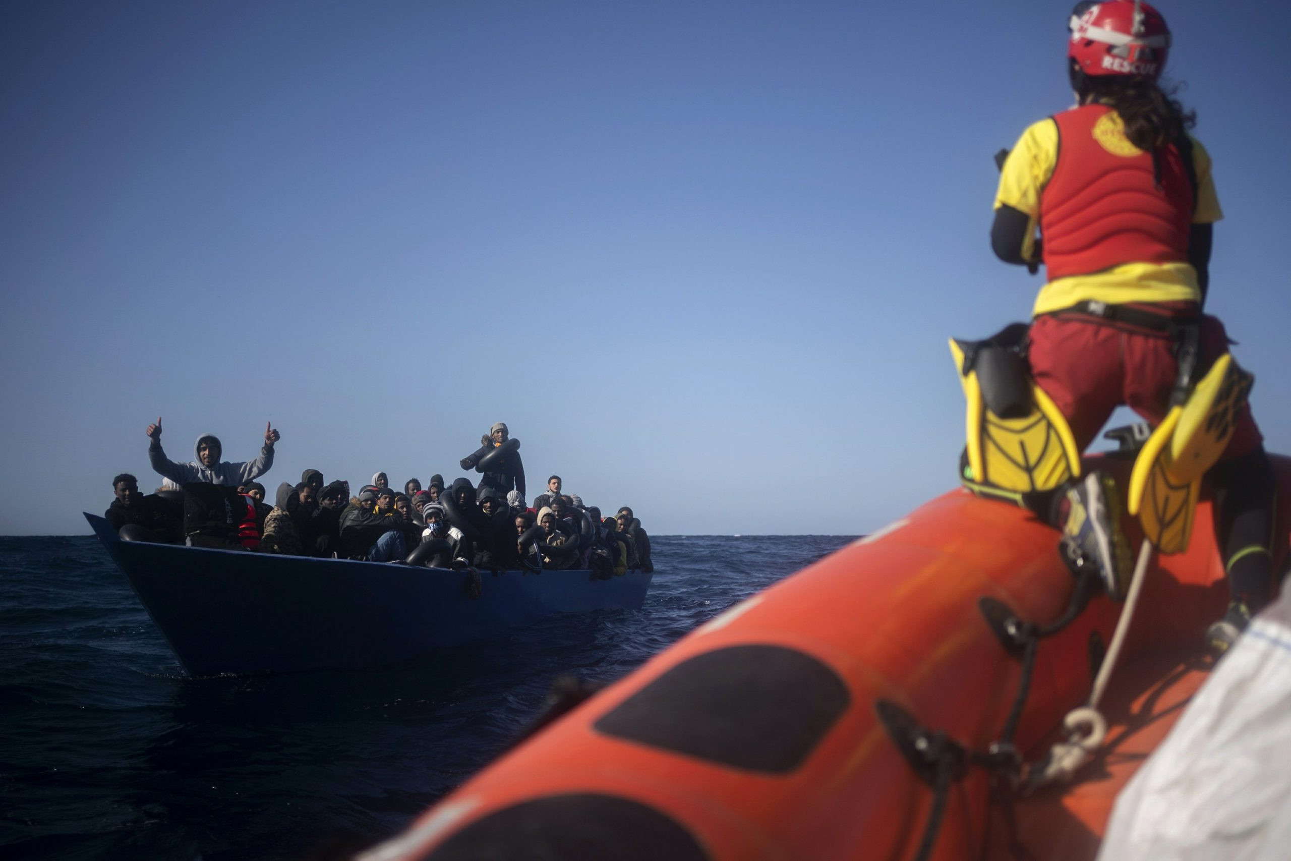 A boat raising the Spanish flag rescues 265 migrants in the Mediterranean