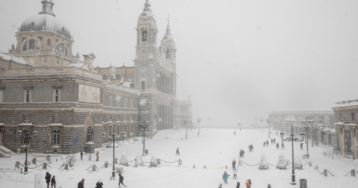 A rare snowstorm in Spain kills 4 and freezes the country