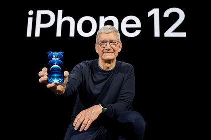 File Image: Apple CEO Tim Cook stands with the iPhone 12 Pro at Apple Park in Cupertino, California, US, in a photo released on October 13, 2020. Brooks Kraft / Apple Inc.  / Via REUTERS