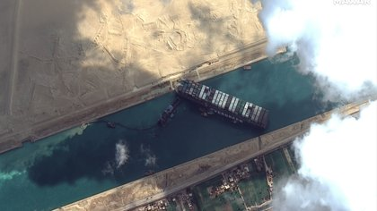 The container ship Evergiven is stuck in the Suez Canal in this image taken by the Maxar Technologies satellite on March 26, 2021. Maxar Technologies / Handout via REUTERS