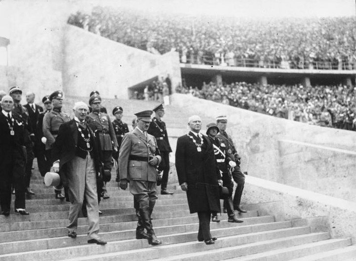 Historical photo of Hitler entering the Olympic Stadium in Berlin.