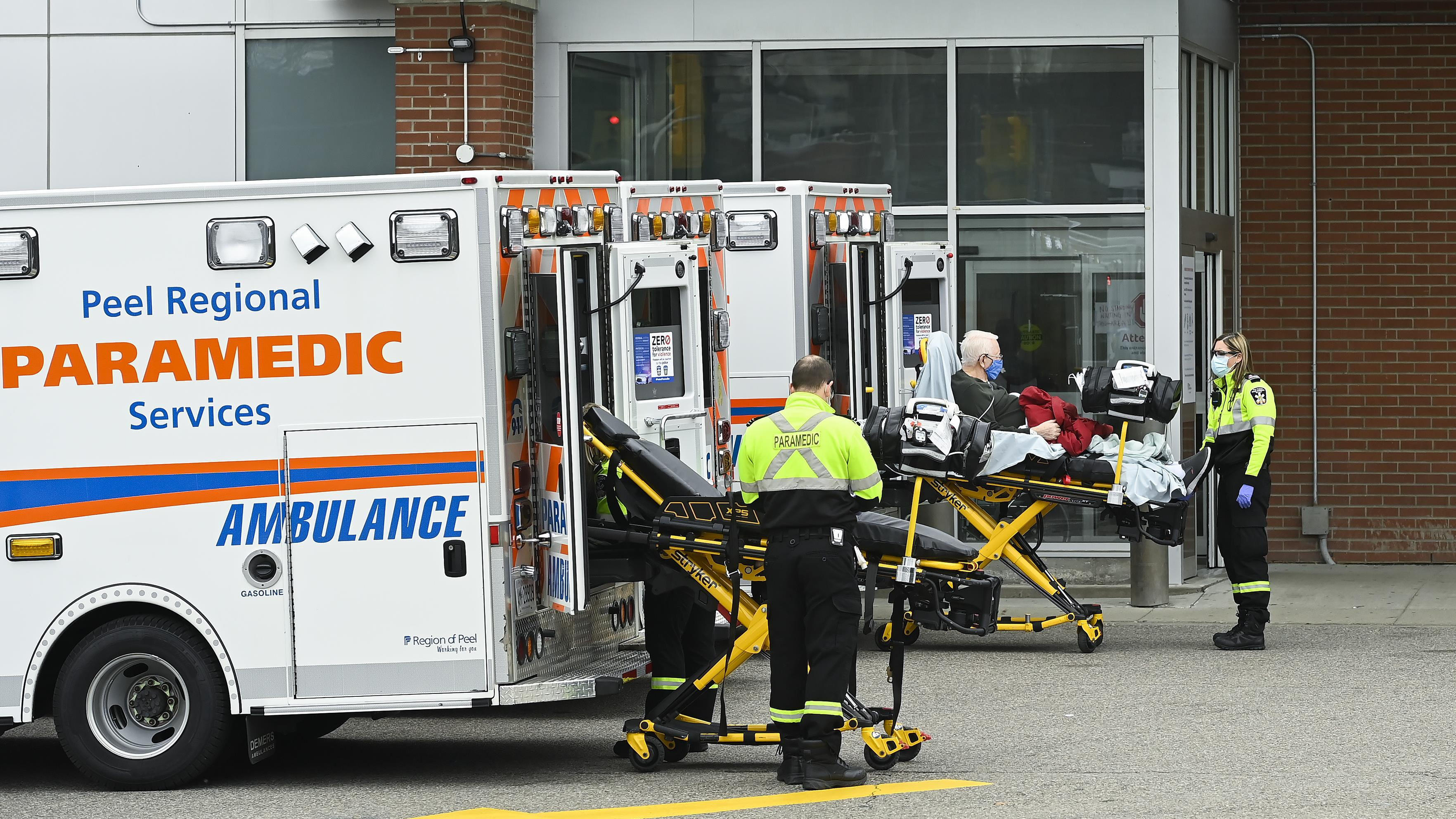 Two ambulances near the emergency entrance of a hospital in Ontario.