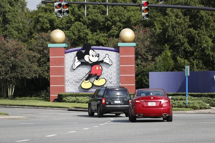 Lake Buena Vista, Florida - July 11: A view of a Mickey Mouse painting at the entrance to Walt Disney World theme park on July 11, 2020 in Lake Buena Vista, Florida.  The park has reopened despite an increase in new cases of COVID-19 across Florida, including the central part of the state where Orlando is located.  Octavio Jones / Getty Images / AFP