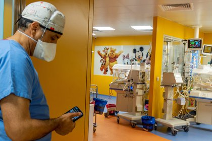 A member of the medical team in the room where the children are being looked after (AFP)