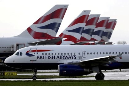 File picture: A British Airways plane passes Terminal 5 at London's Heathrow Airport on March 14, 2020. (Reuters) / Simon Dawson