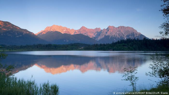 Tranquil lake with mountains in the background.