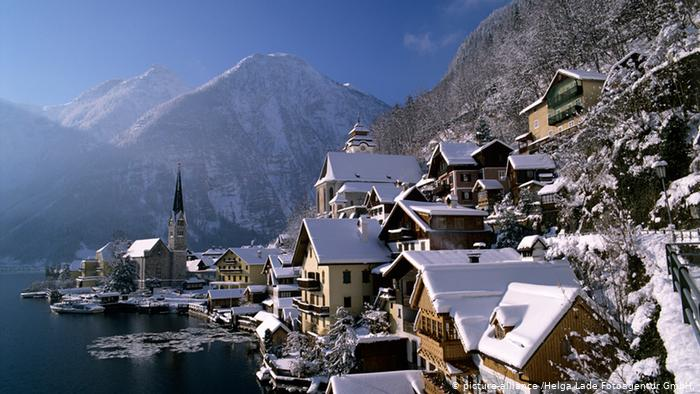 Austrian city postcard, rooftops covered in snow.