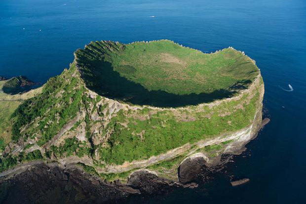 A volcanic view of Jeju Island (South Korea).  The volcanic landscapes and lava tunnels of Jeju Island, in southwestern South Korea, have made it triple UNESCO: World Heritage, Global Geoparks, and Biosphere Reserve.
