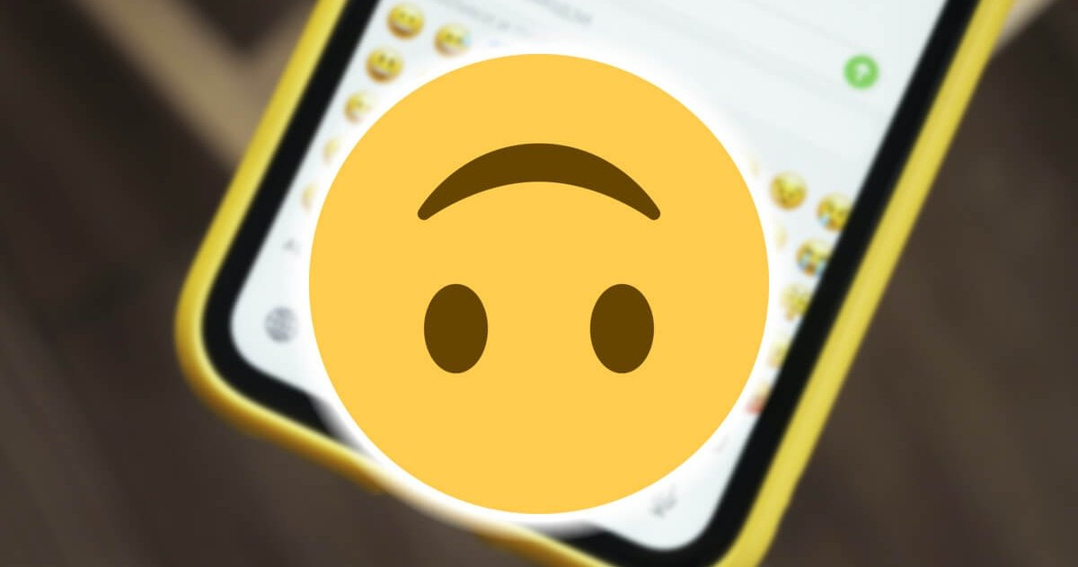 What does the inverted face emoji mean and when should it be used on WhatsApp?