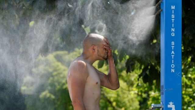 A person cools off from the heat in Vancouver.