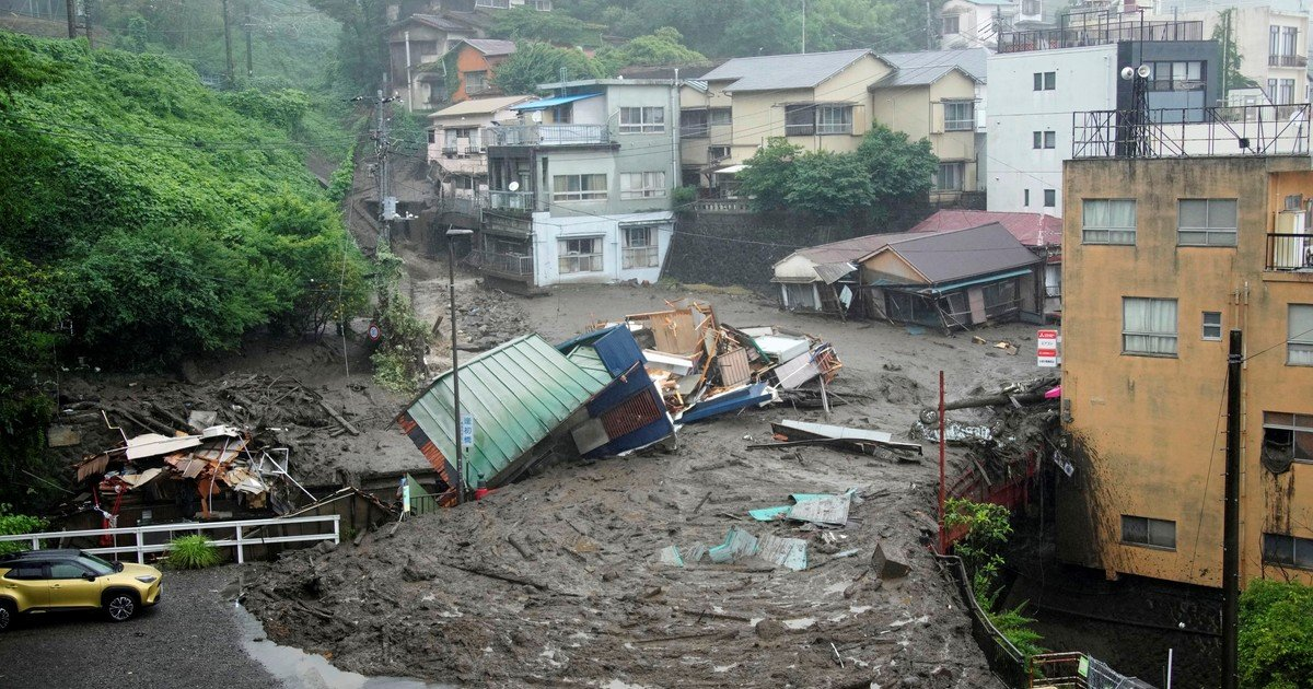 Dramatic photos of mudslide with 20 missing in Japan