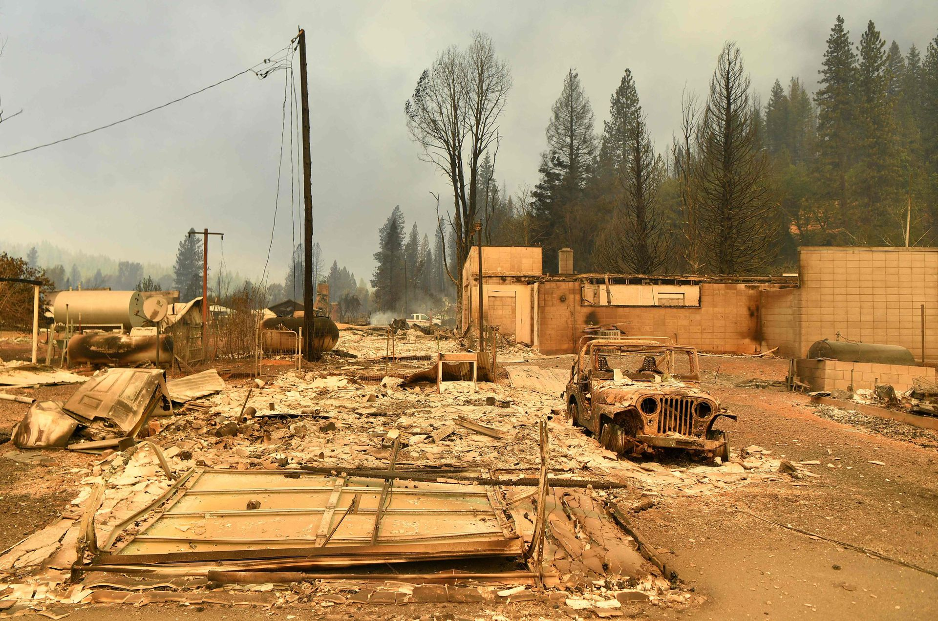 California's largest wildfire devastated a small town, destroying historic buildings hours after residents were ordered to flee.