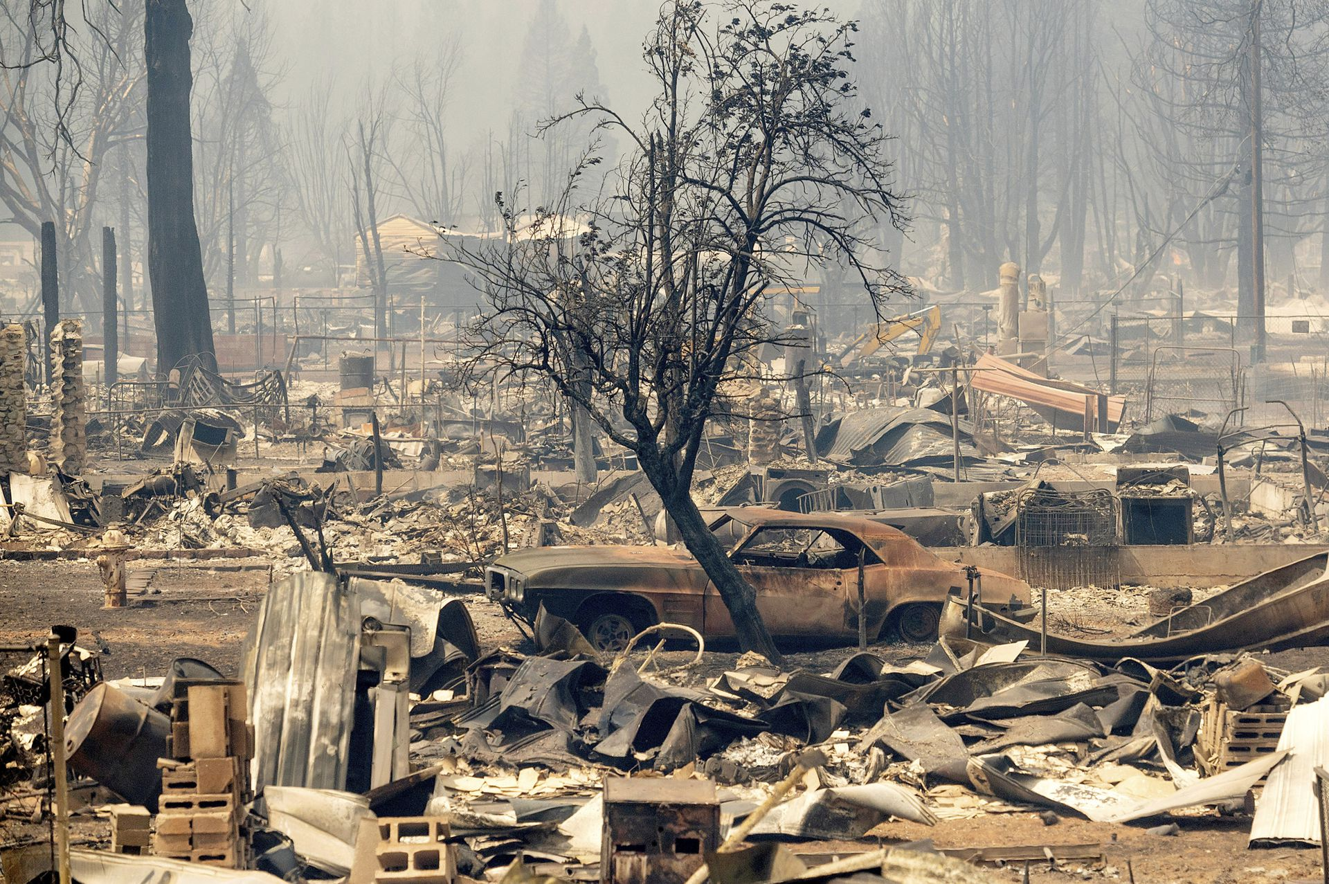 Homes and cars destroyed by fire in downtown Greenville, Plumas County, California