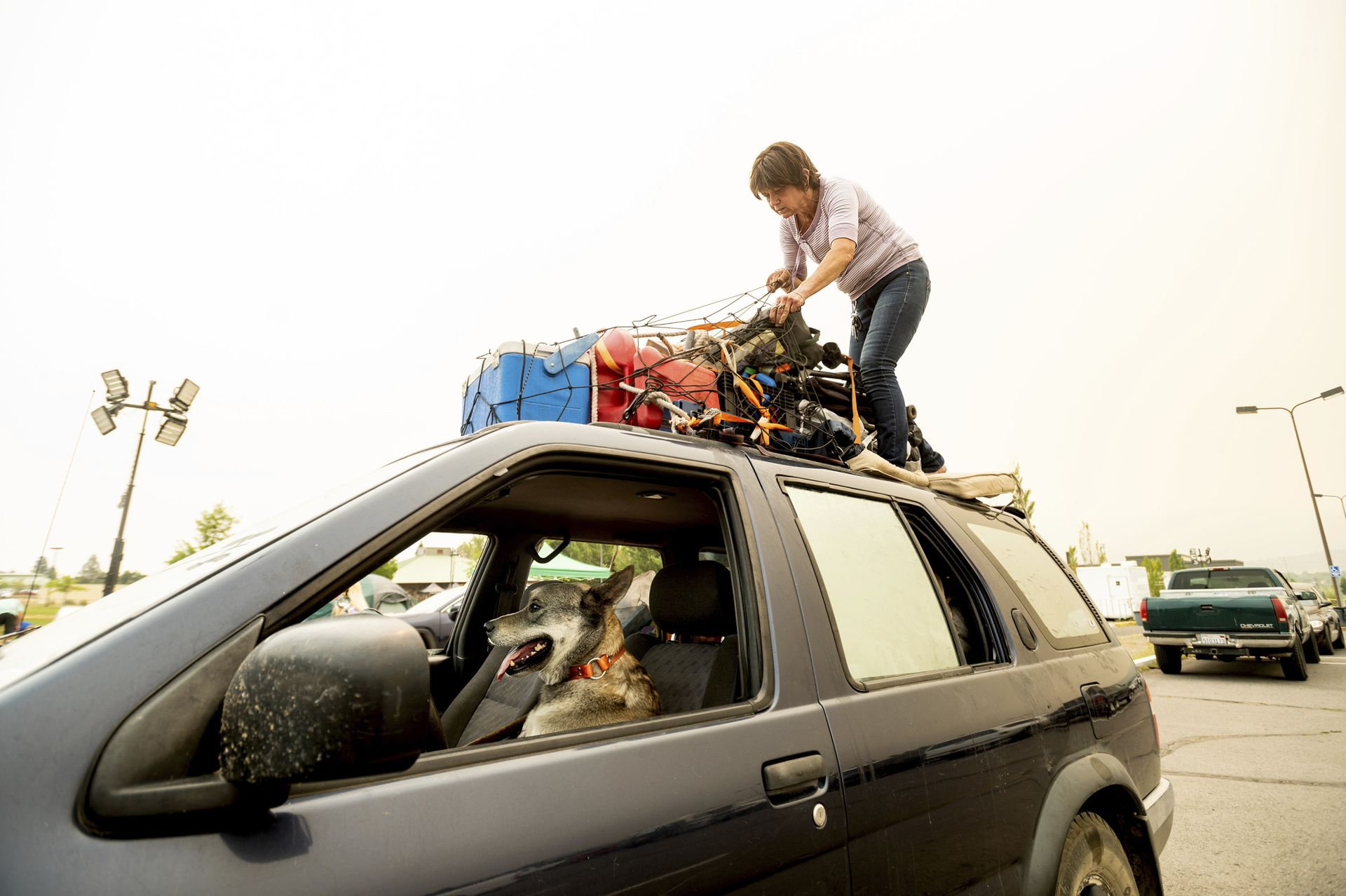 """Greenville resident Kesia Studebaker, who lost her home in the Dixie fire, secured her property before leaving an evacuation shelter in Susanville, California.  Accompanied by her dog Logan. """"I lost everything.  That's all I left""""Studebaker said and added """"It's a new beginning, a new adventure"""""""
