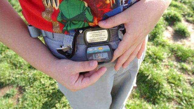 A person with a pedometer.