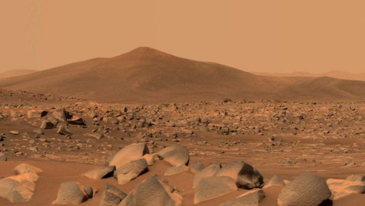 This image shows Santa Cruz, a hill located 2.5 km from the rover.  The entire scene inside Jezero crater on Mars.  The edge of the crater can be seen on the horizon line behind the hill.